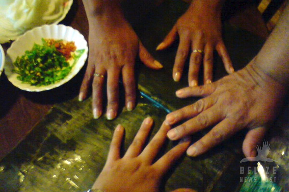 Many Hands to make Belizean Tamales