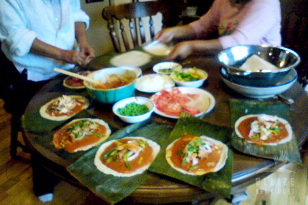Assembling Belizean Tamales